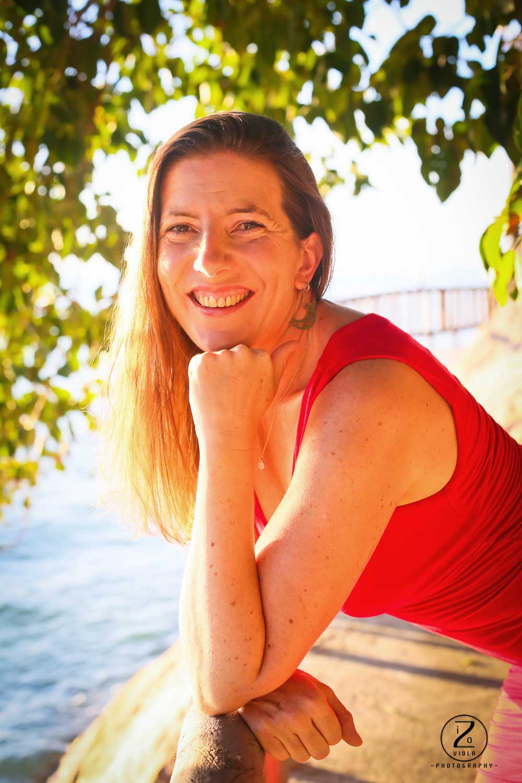 Sex coach, Sarah Rose Bright in red dress