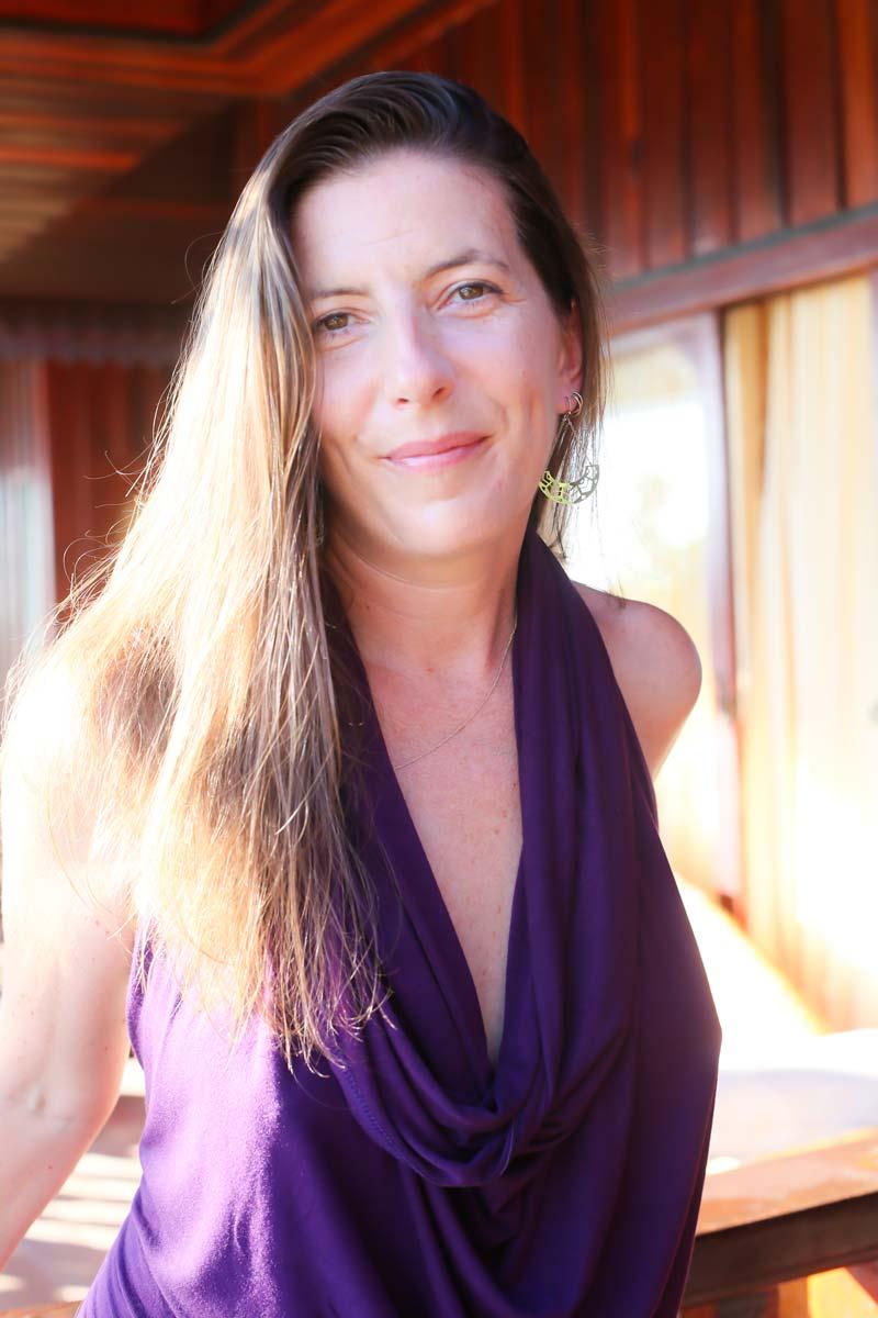 Sex coach, Sarah Rose bright in purple top