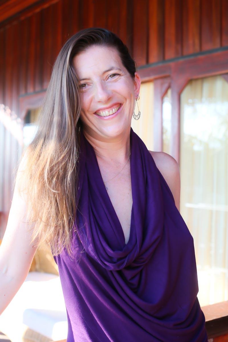 Sex coach, Sarah Rose Bright smiling in purple top